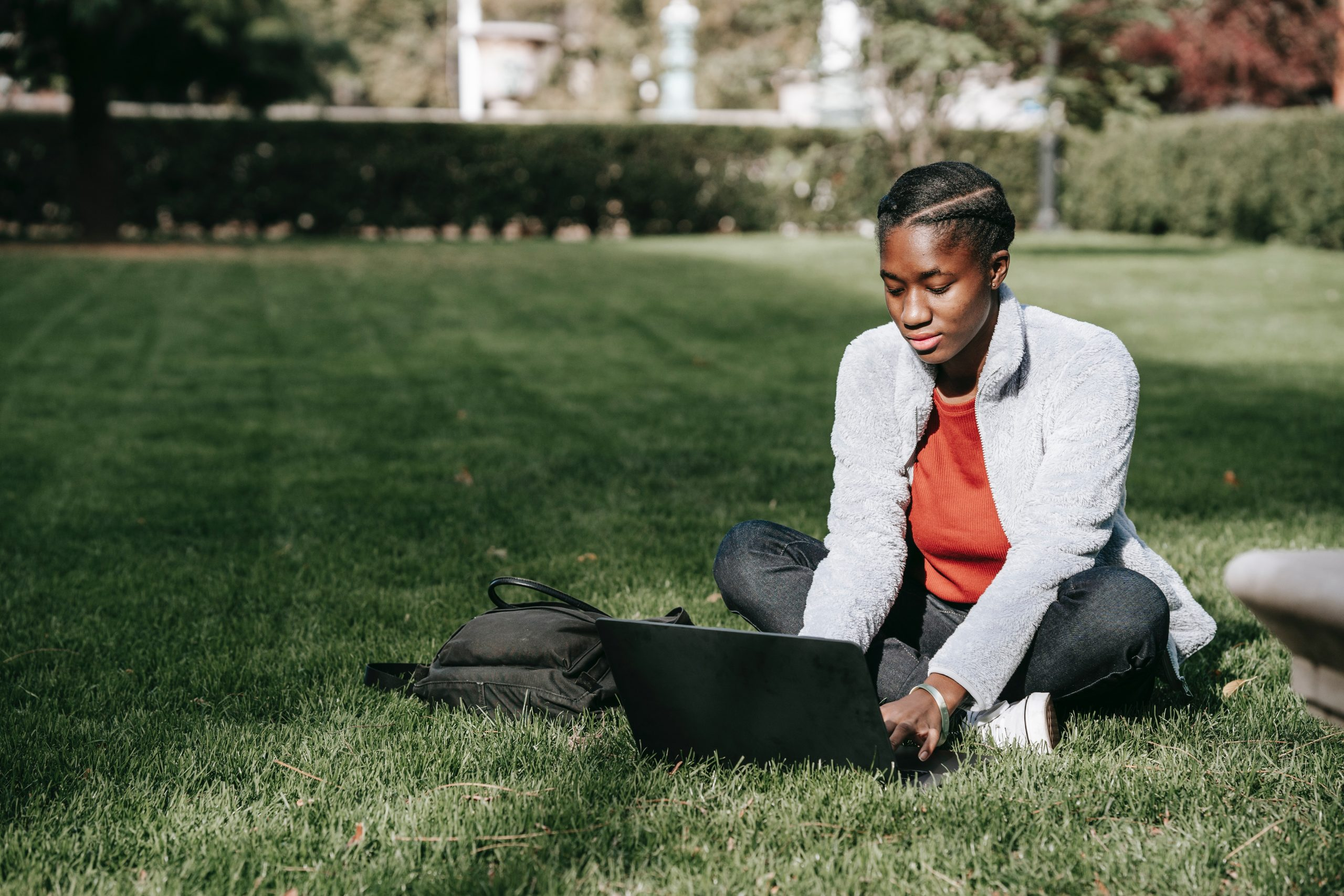 College Student Studying Outside on a Laptop